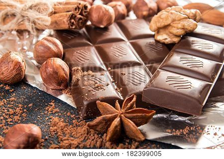 Chocolate Pieces, Filbert, Chocolate Shavings And Walnut On Dark Background.
