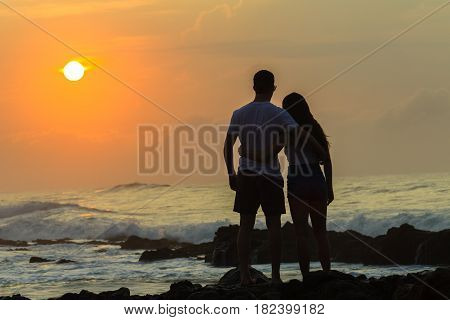 Girls Boy Silhoueted Sunrise Ocean