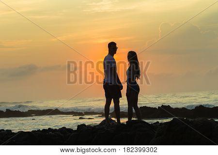 Girls Boy Silhoueted Sunrise Ocean