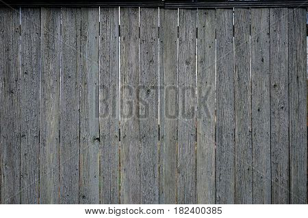 The Texture Of An Old Rustic Wooden Fence Made Of Flat Processed Boards