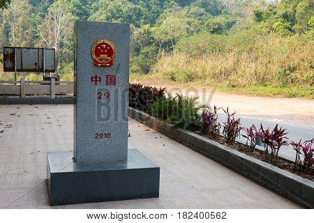 Mohan, China - Mar 08 2015: Laos - China Border Marker Between Boten, Luang Namtha Province, Laos An