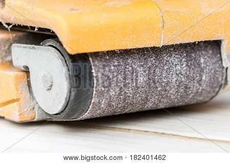 Old Dusty Electrical Sandpaper On The Wooden Board