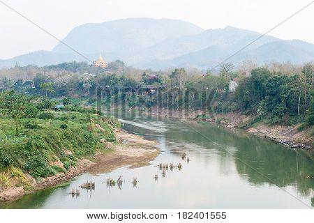 Luang Prabang, Laos - Mar 05 2015: Nam Khan River At Luang Prabang. A Famous Ancient City In Luang P
