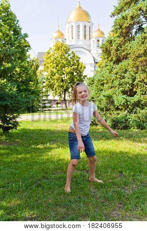 Photo of dancing girl with sore knee in summer