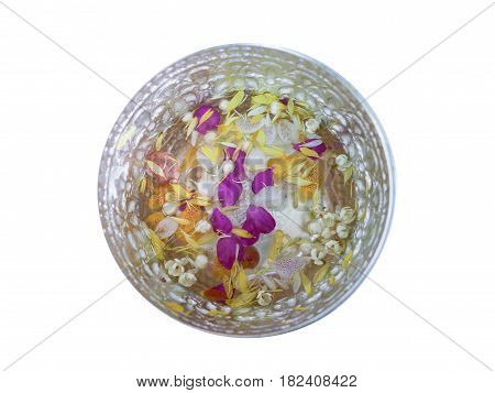 Top view of aluminum bowl isolated with jasmines and orchids float on a water for Songkran aka Thai New Year's festival in Thailand