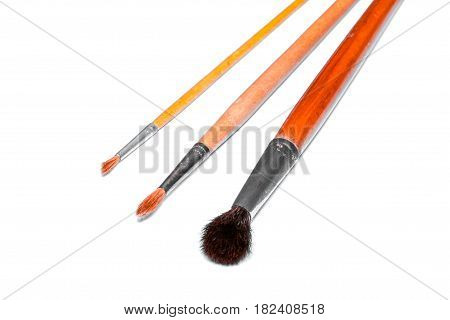 Three different brushes for watercolor painting on white background. Isolated.