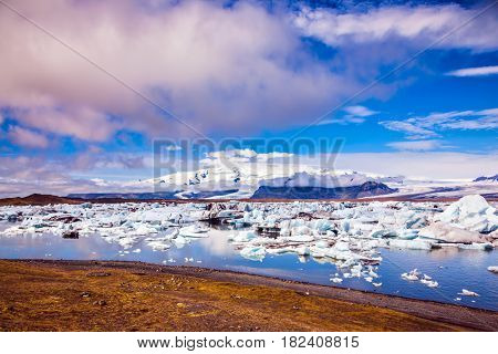 The clouds and ice floes of lagoon Jokulsarlon, Iceland. Clouds reflected in the water of lagoon. The concept of northern extreme tourism