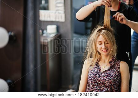 Hair Stylist Makes The Bride A Wedding Hairstyle At Beauty Salon.