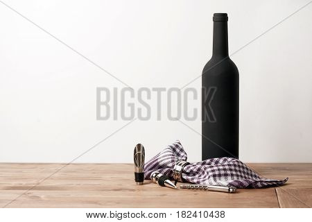 Vine bottle and Sommelier set on wooden table with white background. Close up