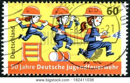 GERMANY - CIRCA 2014: A stamp printed in Germany dedicated to the 50th Anniversary of Young Firefighters circa 2014