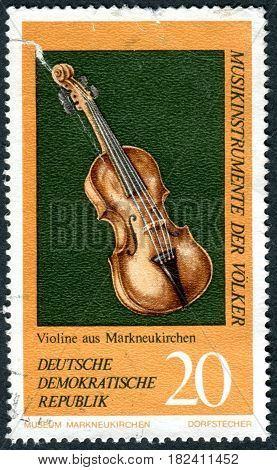 GERMANY - CIRCA 1971: A stamp printed in Germany (GDR) shows the musical instrument from Germany Violin circa 1971