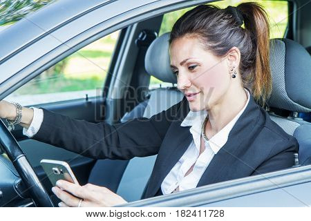 Happy Woman In His New Car  With Mobile Phone
