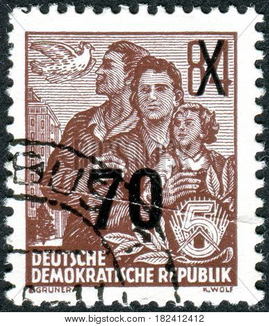GERMANY - CIRCA 1953: A stamp printed in Germany (GDR) is dedicated to the five-year plan shows Dove and East German family circa 1953
