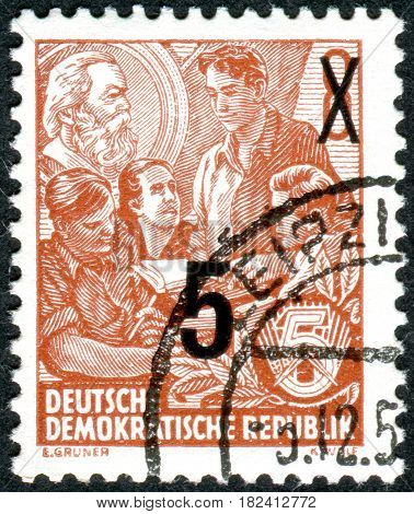 GERMANY - CIRCA 1953: A stamp printed in Germany (GDR) is dedicated to the five-year plan shows a study of Marxism circa 1953