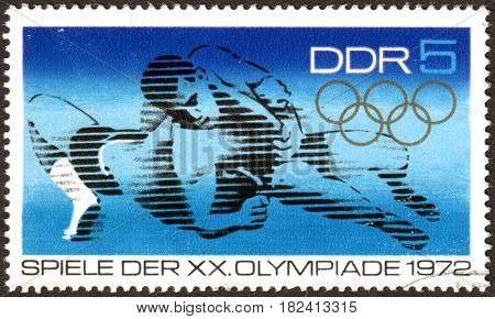 GERMANY - CIRCA 1972: A stamp printed in Germany (GDR) dedicated to Summer Olympics 1972 Munich shows the Wrestling circa 1972
