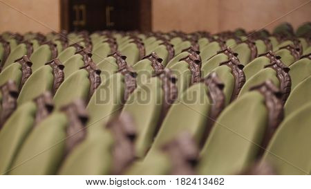 Concert Hall - spectators come into green chairs - de-focused time-lapse, close up