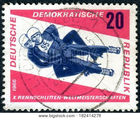 GERMANY - CIRCA 1966: A stamp printed in Germany (GDR) dedicated to 10th International Tobogganing Championships Friedrichroda shows a men's doubles circa 1966