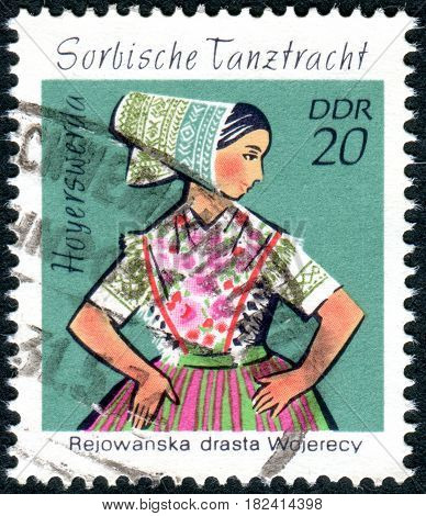 GERMANY - CIRCA 1971: A stamp printed in Germany (GDR) shows the Sorbian Dance Costumes from Hoyerswerda circa 1971