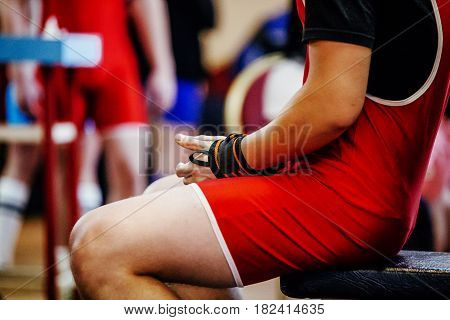 athlete powerlifter sitting in hand wristbands competition bench press