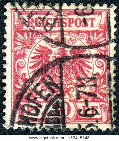 GERMANY - CIRCA 1889: A stamp printed in Germany (Deutsches Reich) shows a Imperial eagle in a circle circa 1889