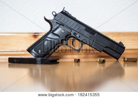 Gun on the floor crime the shell of the bullets next to the gun robbery murder crime mafia crime scene