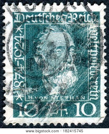 GERMANY - CIRCA 1924: A stamp printed in Germany (Deutsches Reich) shows a portrait of a general post director for the German Empire Heinrich von Stephan circa 1924
