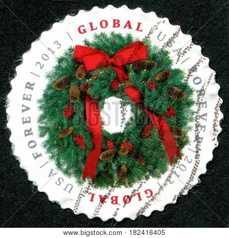 USA - CIRCA 2013: A stamp printed in the USA shows the Christmas wreath circa 2013