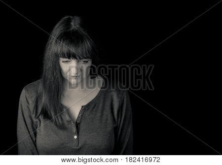 Portrait Of A Mature Troubled Woman Looking Down.