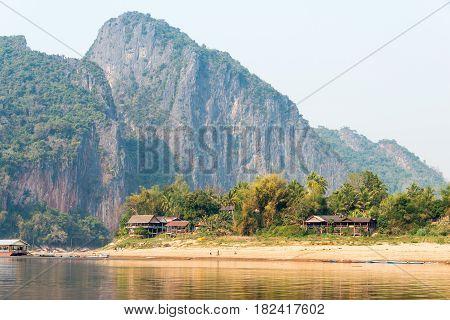 Luang Prabang, Laos - Mar 04 2015: Slow Boat Cruise On The Mekong River. Popular Tourist Adventure T