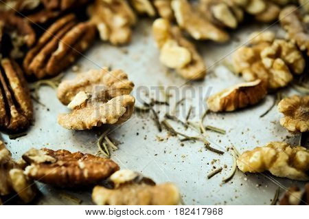 Healthy mixed nuts - walnut and pecan with rosemary