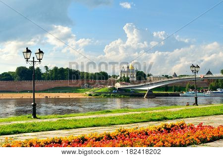 VELIKY NOVGOROD RUSSIA - AUGUST 5 2016. Veliky Novgorod Kremlin and embankment near the Volkhov river in summer cloudy day. Focus at the Kremlin. Architecture view of Veliky Novgorod Russia