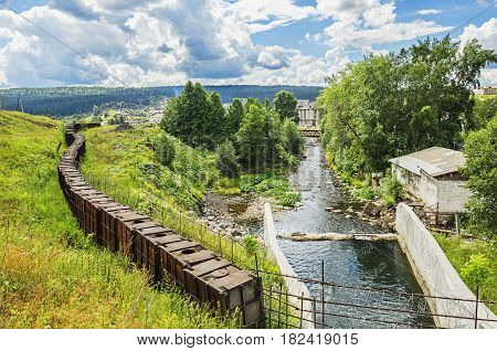 Dam metallurgical plant in summer day. Russia. Ural