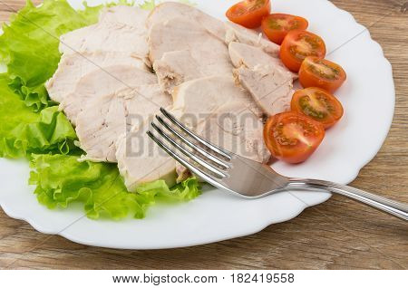 Pieces Of Boiled Chicken Meat, Lettuce, Fork And Tomatoes