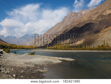 Ghizer River Autumn Landscape Along Hindu Kush Mountain Range In Ghizer Valley, Northern Pakistan