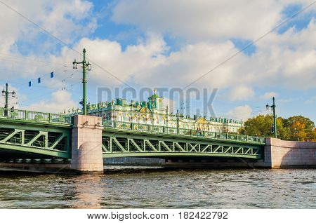 ST PETERSBURG RUSSIA-OCTOBER 3 2016. Winter Palace on the embankment of Neva river and Palace bridge in St Petersburg Russia. Architecture landscape of St Petersburg, Russia