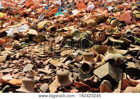 Broken clay pottery and pots lining the ground in south vietnam near a pottery factory.