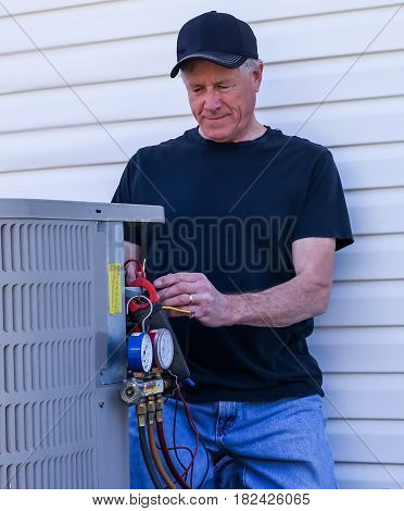 HVAC Technician Repairing Central Air Conditioning System