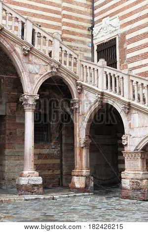 Staircase of reason in courtyard the Palazzo della Ragione. Verona, Italy