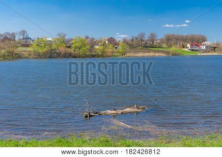 Pictorial spring landscape with Suha Sura river in Vasylivka village near Dnepr city central Ukraine