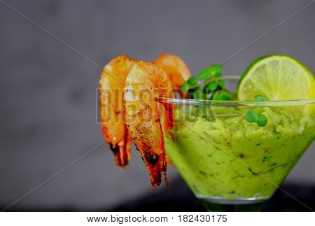 shrimp cocktail appetizer with avocado and lime