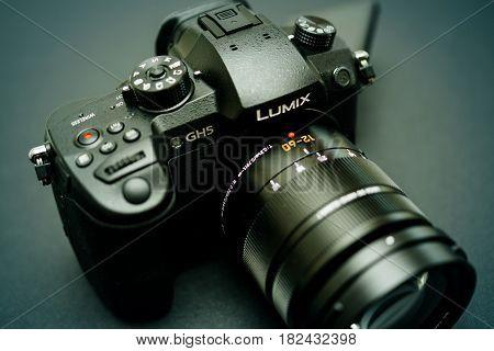 PARIS FRANCE - APR 9 2017: Green tone of the Panasonic Lumix DMC-GH5 - and Leica Vario-Elmarit 12-60 Micro Four Thirds System digital still and video camera with 4K 10 bit Video recording internal capability.