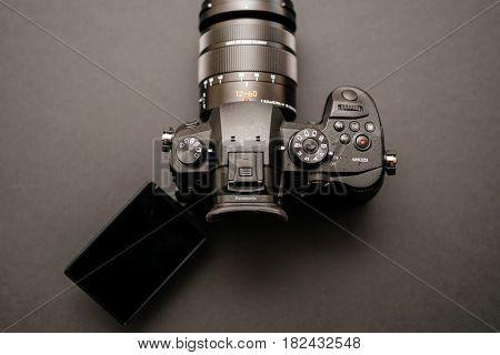 PARIS FRANCE - APR 9 2017: Tilt-screen detail of the Panasonic Lumix DMC-GH5 - and Leica Vario-Elmarit 12-60 Micro Four Thirds System digital still and video camera with 4K 10 bit Video recording internal capability.