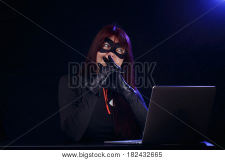 Thief with hands near mouth