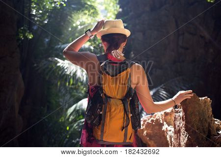 Brunette with hat in ravine