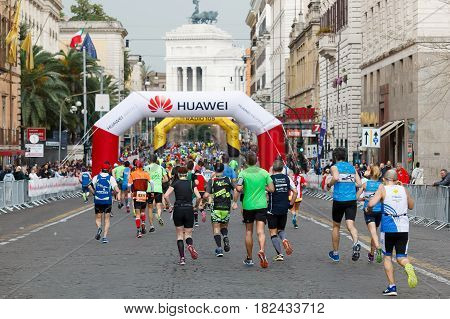 Rome Italy - April 2nd 2017: Athletes of the 23th Rome Marathon to step in Via Nazionale a few kilometers from the finish. In the background the monument to Vittorio Emanuele II.