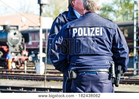 German police man with the blue jacket and police letters