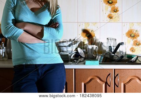 Fragment Of The Female Body At The Kitchen Counter, Filled With A Lot Of Unwashed Dishes