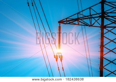high-voltage power lines . electricity distribution station at sunset .