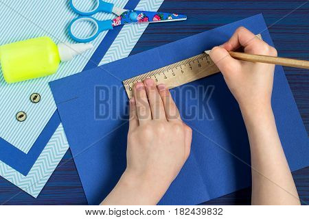 Making greeting card for Father's Day. Children's art project. DIY concept. Step-by-step photo instruction. Step 2. Child makes card layout