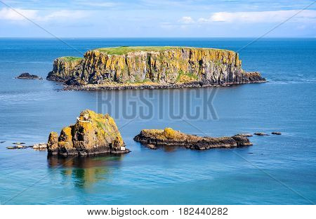 The Sheep Island and two smaller ones near Ballintoy, Carrick-a-Rede and Giant's Causeway, North Antrim Coast, County Antrim, Northern Ireland, UK